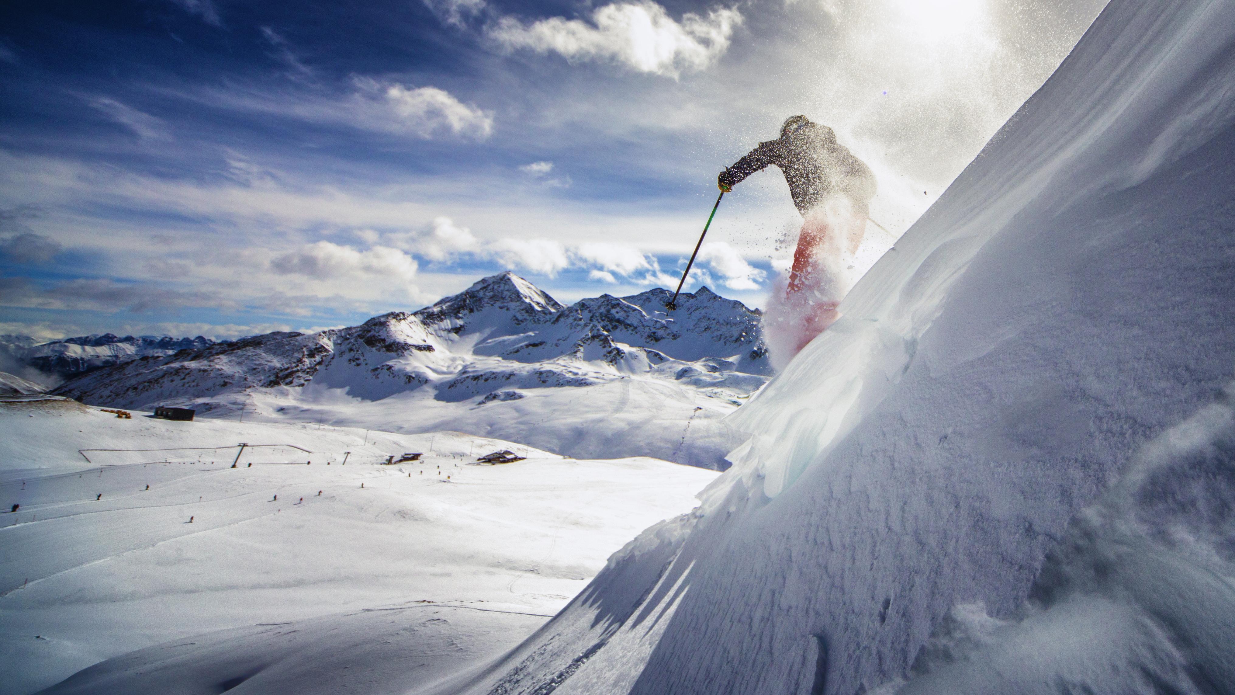Skiier going down mountain